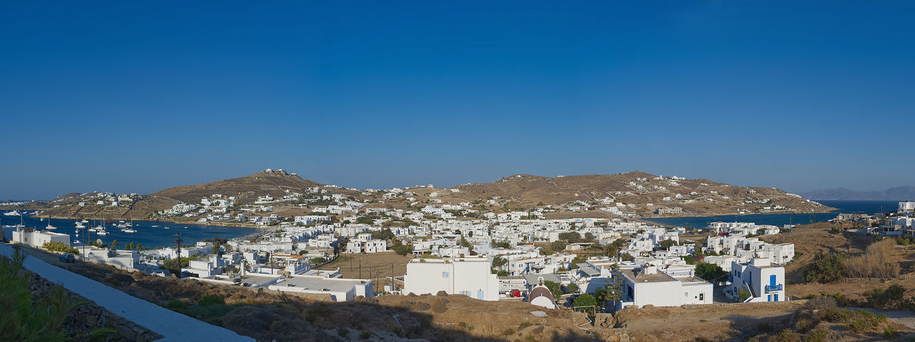 Ornos village - Mykonos island - Aegean sea - Greece Aegean Architecture Beauty In Nature Blue Building Building Exterior Built Structure City Cityscape Clear Sky Copy Space Greece Landscape Mountain Mountain Range Mykonos Nature Ornos Outdoors Residential District Scenics - Nature Sea Sky Town TOWNSCAPE