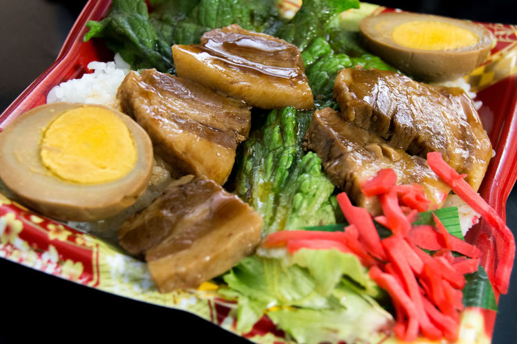 High Angle View Of Boiled Egg With Pork And Rice In Plate