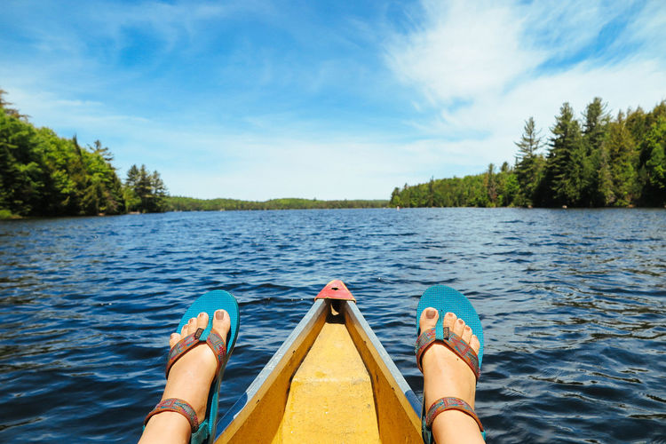 Canoe Canoeing Algonquin Park Algonquinpark Algonquinprovincialpark Beauty In Nature Cloud - Sky Day Human Body Part Human Leg Kayak Lake Low Section Nature Nautical Vessel One Person Outdoors People Personal Perspective Real People Sky Tree Water Yellow