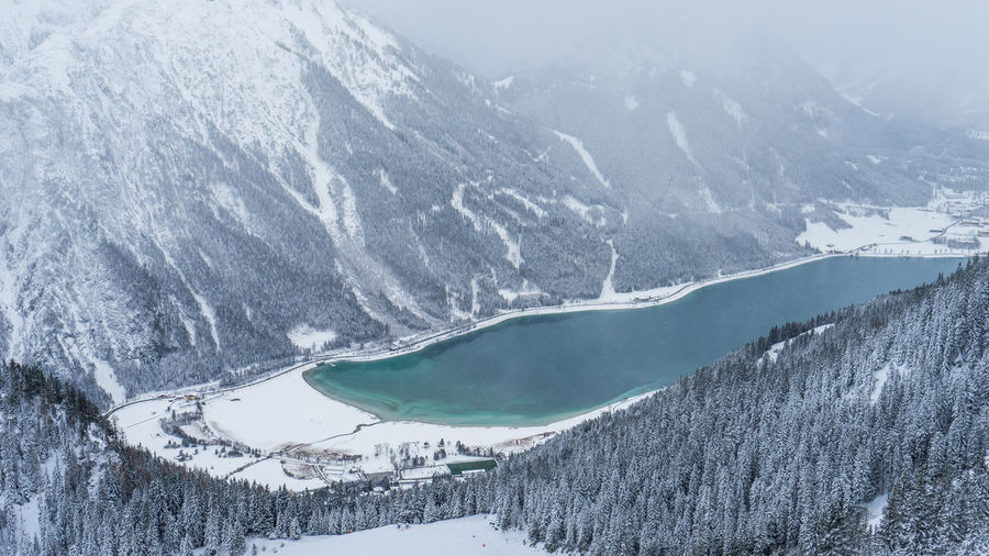 Achensee Austria Tirol  Beauty In Nature Cold Temperature Day Foggy Frozen Ice Lake Landscape Mountain Mountain Range Nature No People Outdoors Scenics Snow Snowcapped Mountain Tranquil Scene Tranquility Water Weather Winter Shades Of Winter