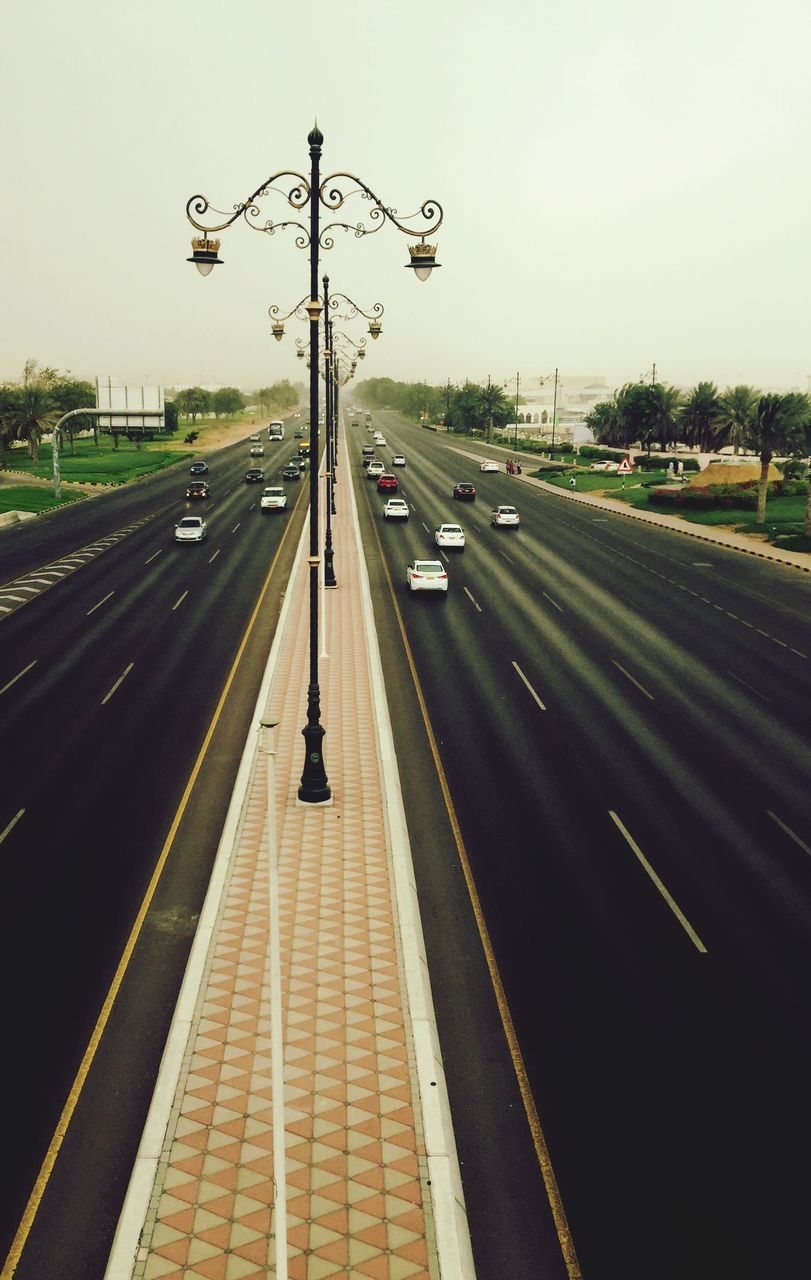 High Angle View Of Cars Moving On Road Against Sky