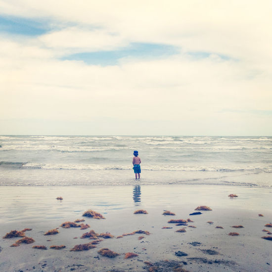 Beach Beach Life Boy Carefree Child Coastline Getting Away From It All Horizon Over Water Little Boy Outdoors Sand Sea Seascape Shore Vacation Vacations Water Wave