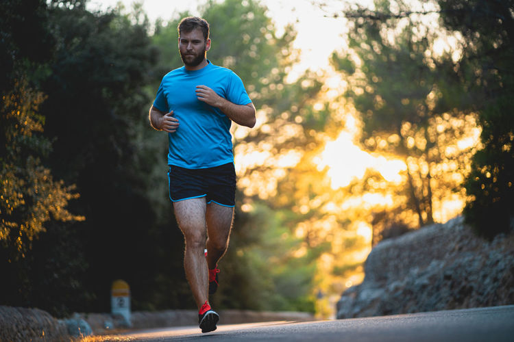 Full length portrait of young man running