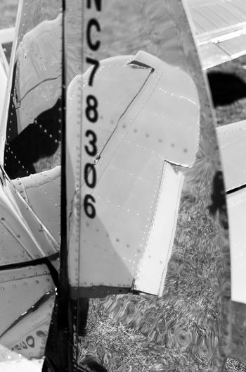 Plane chromatic Mirror Plane Airport Aviation Aviationphotography Blauck And White Chromatic Close-up Day No People Plane Parking Rudder Silver