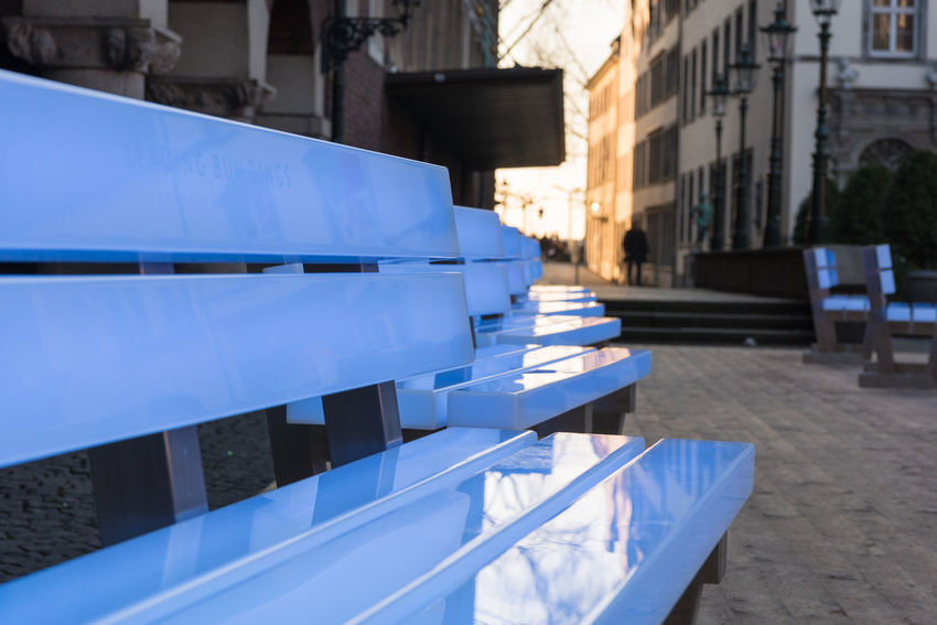 "DUESSELDORF, GERMANY - FEBRUARY 13, 2017: Eighteen illuminated benches by the artist Bernd Spiecker decorate the Old market during the city program ""Drand Depart"" - changing their colours permanently Altstadt Altstat Architecture Beauty In Nature Central Park Dusk History Illumination Leuchgtende Bänke Old Market Shining Benche"
