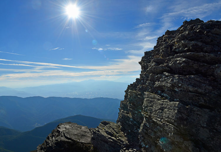 Formation Mountain Peak Outdoors Sunbeam No People Lens Flare Solid Cloud - Sky Non-urban Scene Sunlight Mountain Range Rock - Object Nature Tranquility Tranquil Scene Sun Scenics - Nature Beauty In Nature Sky Mountain Mountain View Rock Japan Nagano EyeEmNewHere