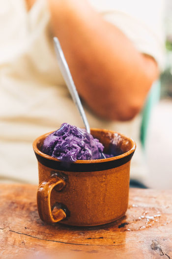ice cream Food And Drink Food Freshness Close-up Healthy Eating Table Wellbeing Indoors  Spoon Wood - Material Kitchen Utensil Eating Utensil Bowl Still Life Ready-to-eat Purple Sweet Food No People Selective Focus Temptation Common Beet Ice Cream Cup Mug Backgrounds Copy Space Object Isolated Snack Treat Yum Sweet Sugar Happiness Happy Food Condensation Cold Temperature Favorite Portrait Orientation Brown Melting Abundance Eating Dining Out Cafe Joy Lifestyles People Body Part Hand
