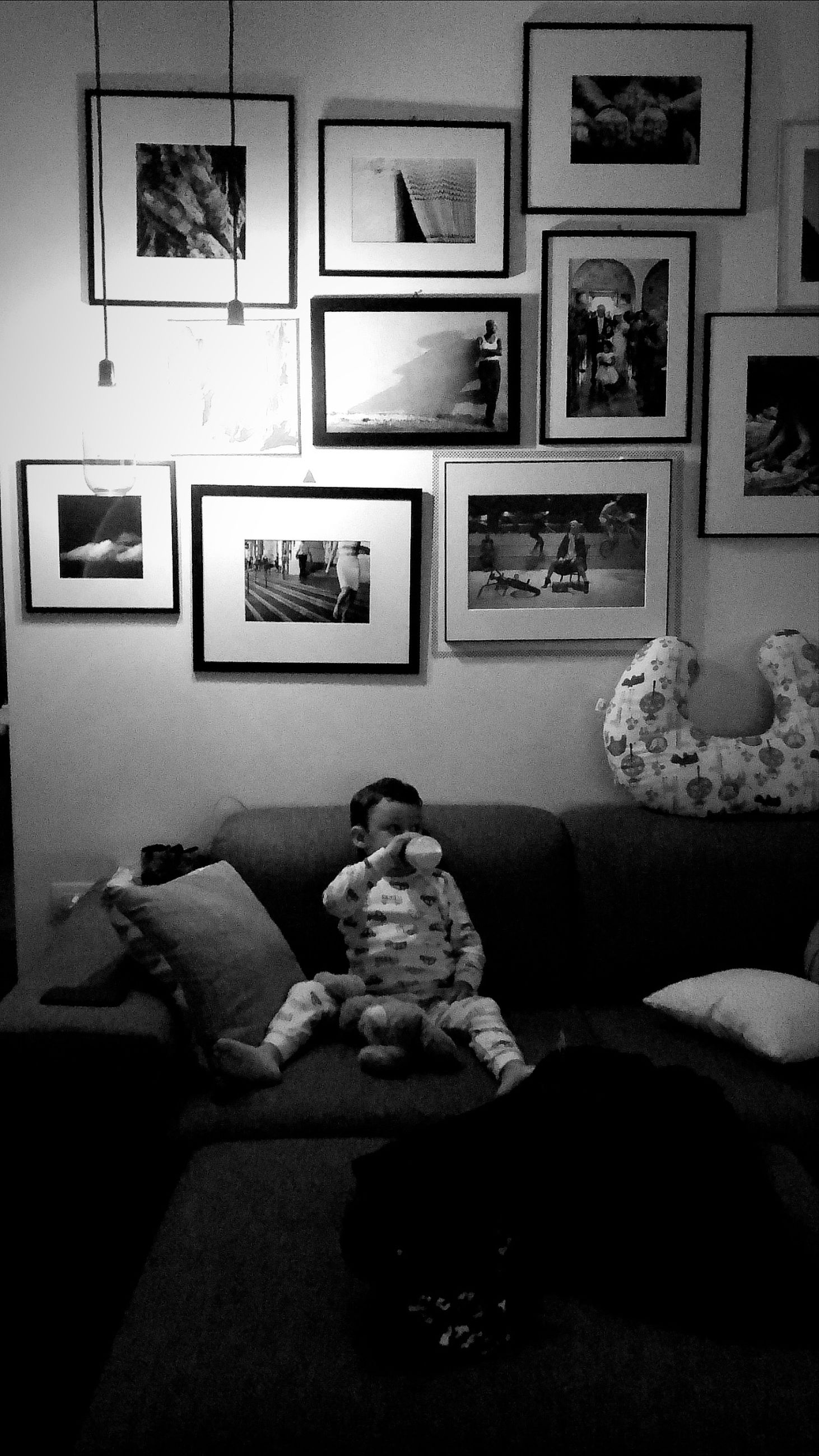picture frame, domestic room, indoors, frame, furniture, home interior, full length, television set, sitting, living room, people, child, relaxation, lifestyles, sofa, real people, representation, domestic life, childhood, innocence, watching tv