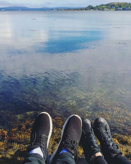 Isle of Oban Scotland Low Section Person Shoe Water Personal Perspective Relaxation Human Foot Vacations Lake Footwear Tourist Tourism Travel Destinations Lakeshore Tranquil Scene Tranquility Sea City Life Day