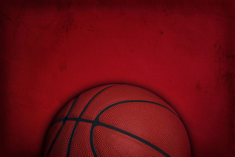 Close-up of basketball against wall