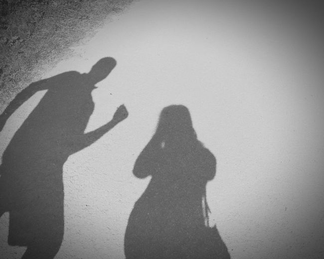 EyeEm Diversity Women Man Shadow Focus On Shadow Sunlight Real People High Angle View Togetherness Bonding Two People Outdoors Adult People Nature Grass Road Day Lifestyles Blackandwhite Art Is Everywhere Live For The Story
