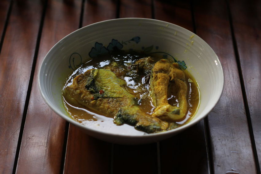Ikan patin masak gulai tempoyak was very famous and also a trademark in Pahang, Malaysia. It also an attractive dish that can be smelled from a distance with tasty creamy sauce. Ikan Patin Tempoyak Culture Pahang Malaysia Exotic Food Expensive Village Style Indoors  Plate
