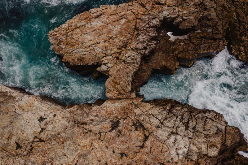 Water Rock Rock - Object Rock Formation Sea Nature No People Solid Beauty In Nature Geology Day Textured  Physical Geography Outdoors Rough Land Close-up Scenics - Nature Tranquility Eroded Power In Nature Wave Crashing Cove Aerial View