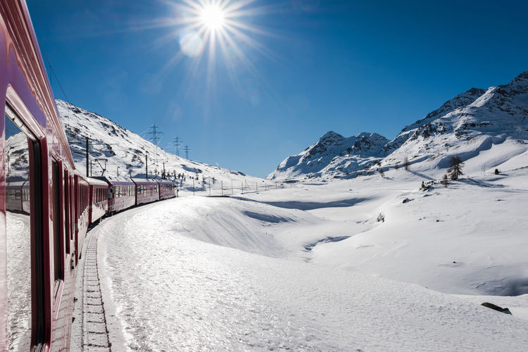 Berninapass Sky Sunlight Winter Cold Temperature Snow Mountain Sun Scenics - Nature Nature Sunbeam Day Beauty In Nature Snowcapped Mountain Covering Environment Sunny Tranquility Lens Flare Mountain Range Bright Train Landscape Winter