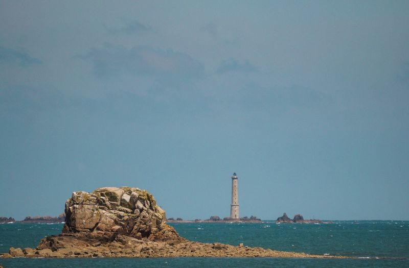 View of lighthouse in calm blue sea