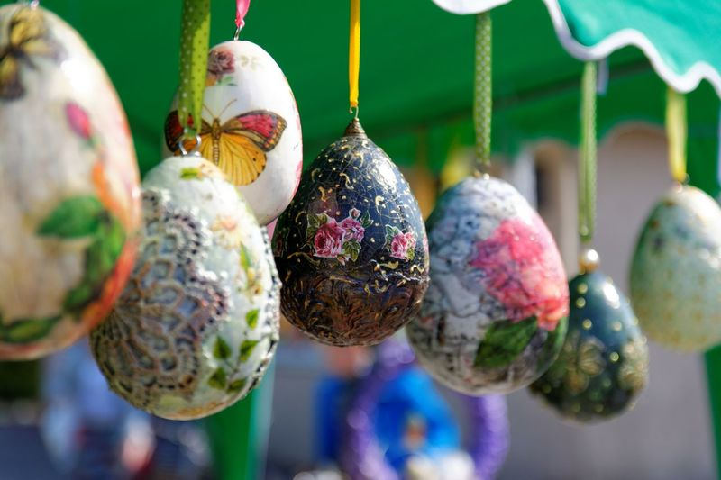 Close-Up Of Colorful Easter Eggs Hanging At Market