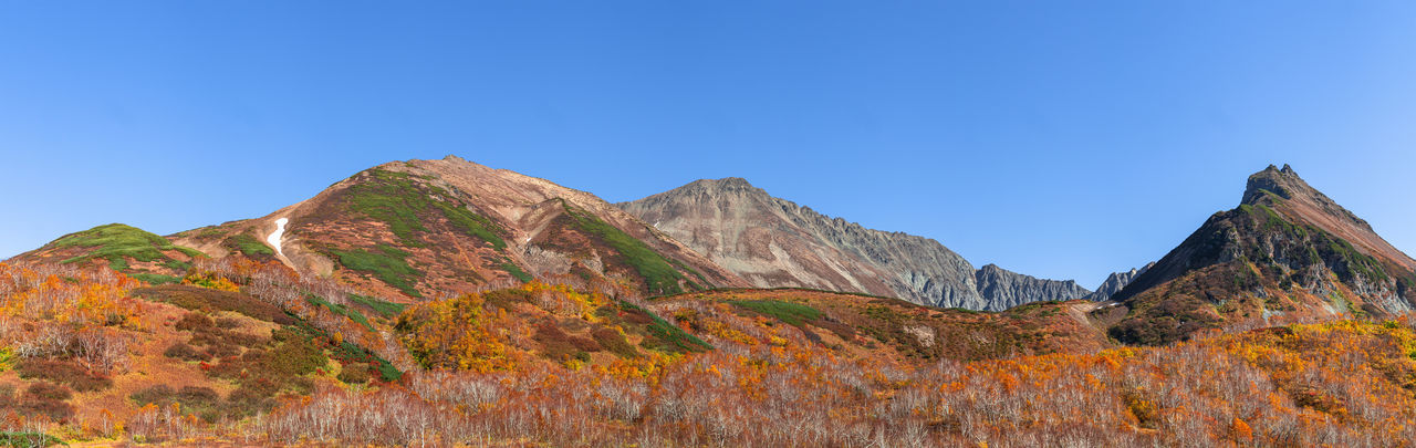 Mountain Scenics - Nature Sky Nature Clear Sky Mountain Range Beauty In Nature Tranquil Scene Environment Tranquility No People Blue Autumn Day Travel Destinations Copy Space Land Landscape Panoramic Plant Outdoors Mountain Peak Formation