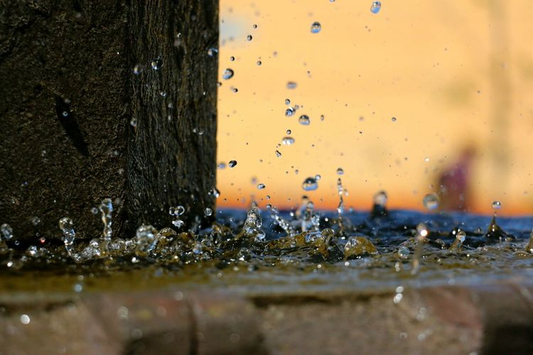 Close-up of drops splashing on fountain
