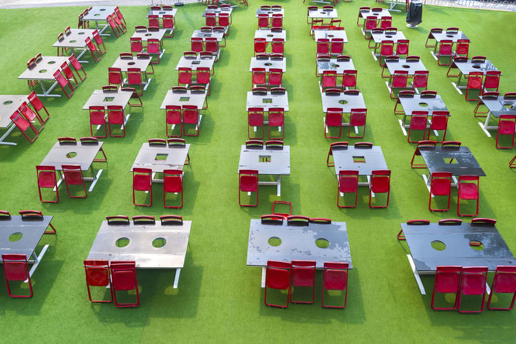 Tables and chairs on grass Abundance Arrangement Cemetery Day Grass Grave Green Color High Angle View In A Row Large Group Of Objects No People Order Outdoors Patriotism Plant Red Repetition Seat Side By Side White Color