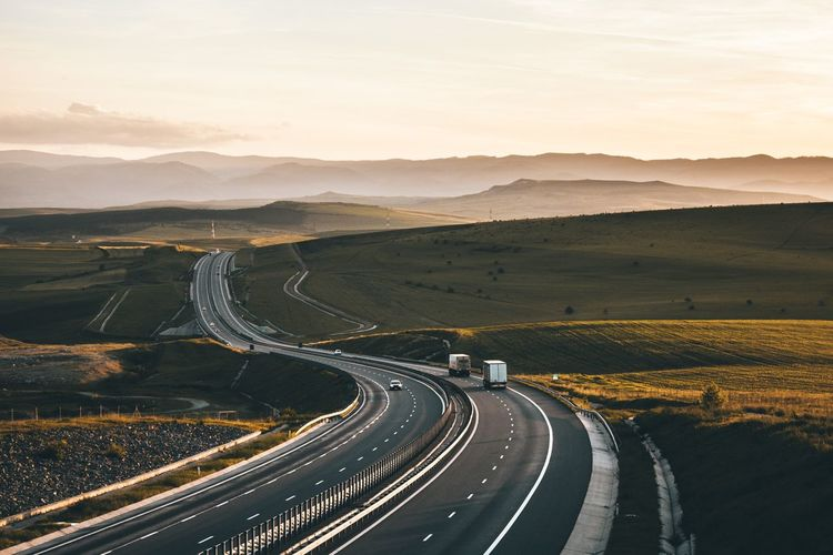 Asphalt Cars Cloud Beauty In Nature Cloud - Sky Curve Direction Dividing Line Environment High Angle View Landscape Mountain Mountain Range Nature No People Non-urban Scene Outdoors Road Scenics - Nature Sky Sunset The Way Forward Tranquil Scene Tranquility Transportation First Eyeem Photo
