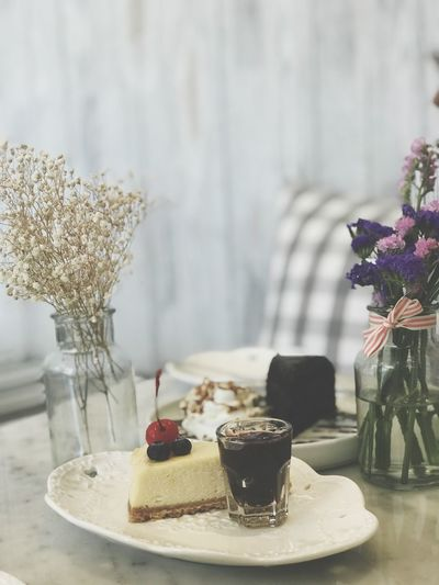 Table Food And Drink Food Sweet Food Freshness Dessert Sweet Plant Flower Focus On Foreground Cake Vase Flowering Plant Indulgence Indoors  Ready-to-eat Baked Still Life Temptation No People