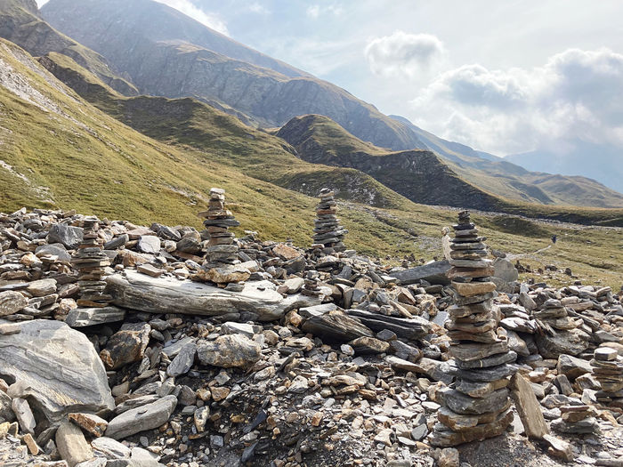 Stack of rocks on mountain against sky