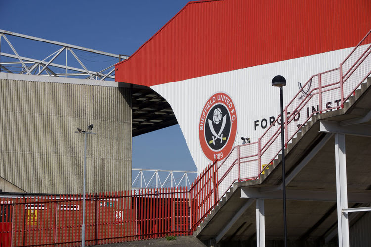 Stands at Bramall Lane Football Ground, Sheffield United. Sheffield Sheffield United Bramall Lane Football Stadium Ground Standing Yorkshire Blades Clear Blue Sky Sunny Summer Built Structure Architecture Building Exterior Sky No People Outdoors Building Sign