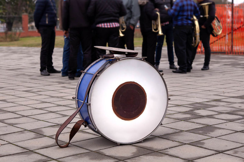 Percussion one. Arts Culture And Entertainment Body Part City Day Drums Focus On Foreground Group Of People Human Body Part Human Leg Incidental People Low Section Men Music Musical Instrument Musician Outdoors People Percussion Instrument Sidewalk Street