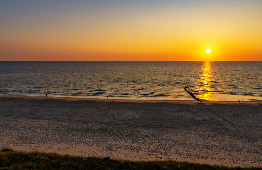 Kampen - Sylt Sonnenuntergang Sylt Strand Sylt, Germany Beach Beauty In Nature Horizon Horizon Over Water Idyllic Nature Ocean Orange Color Outdoors Sand Scenics - Nature Sea Sky Sun Sunset Sylt Tranquil Scene Tranquility Water