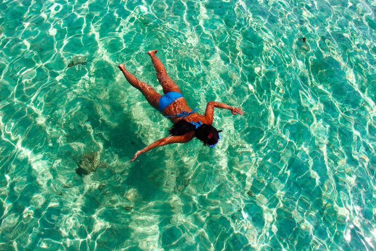 Blue Floating On Water High Angle View Outdoors Summer Tourist Tranquil Scene Turquoise Colored Vacations Water Snorkeling Flying High Women Around The World Live For The Story