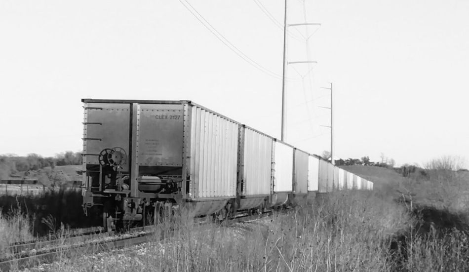 Transportation Train - Vehicle Railroad Track Mode Of Transport Rail Transportation Business Finance And Industry Freight Transportation Outdoors Grass Day No People Rural Scene Sky Locomotive