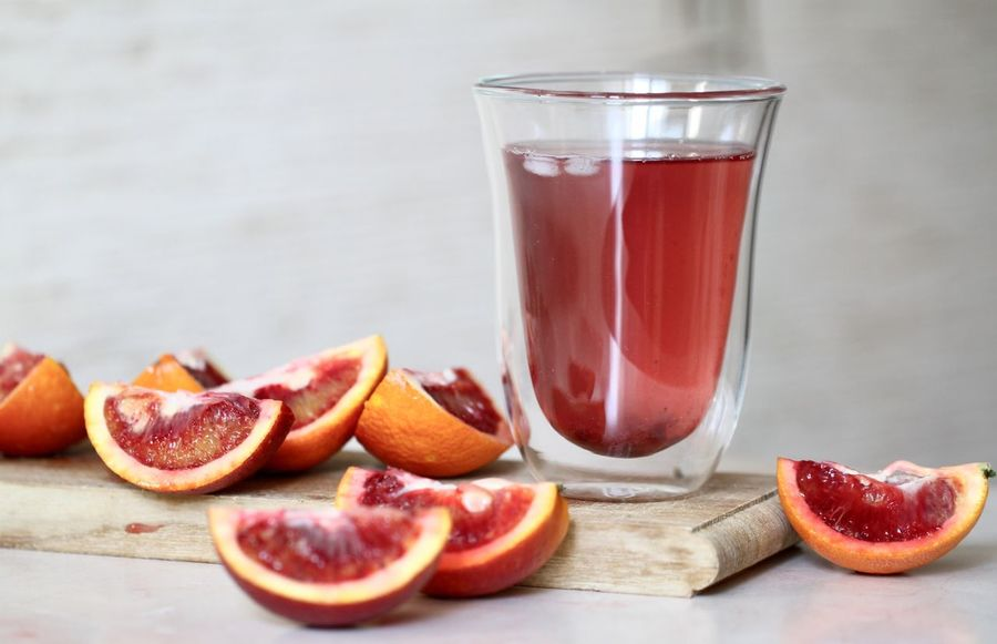 EyeEmNewHere Food And Drink Fruit Healthy Eating Freshness Food Table Drink No People SLICE Drinking Glass Indoors  Close-up Ready-to-eat Pomegranate Seed Seed Blood Orange Day Juice Juicing Juicy Fruit Sicilian Orange Orange Glass Nutrition EyeEmNewHere