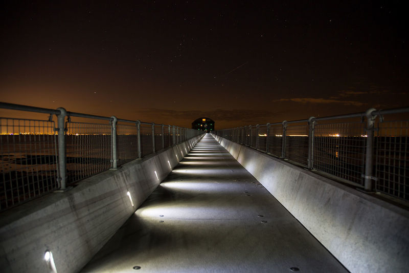 Along the Bridge Leading Lines Structure Concrete Nightphotography Night Time Long Exposure Isle Of Wight  Bembridge Bembridge Lifeboat Station Lifeboat Station... Illuminated Astronomy City Bridge - Man Made Structure Sky Footbridge Milky Way Shore Railing