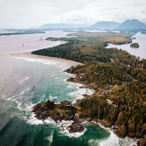 Scenic view of sea and mountains against sky,tofino beach vancouver island from above