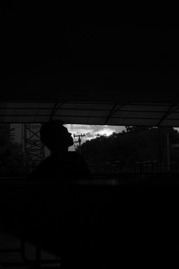 Silhouette man looking at view