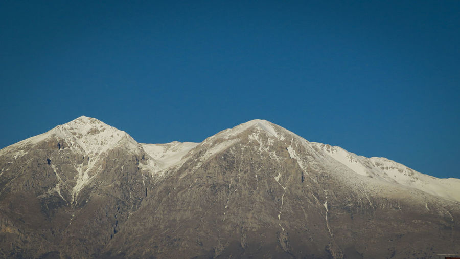 Monte velino, abruzzo italy.  apennines.  mountain range with snowy peaks and blue sky.