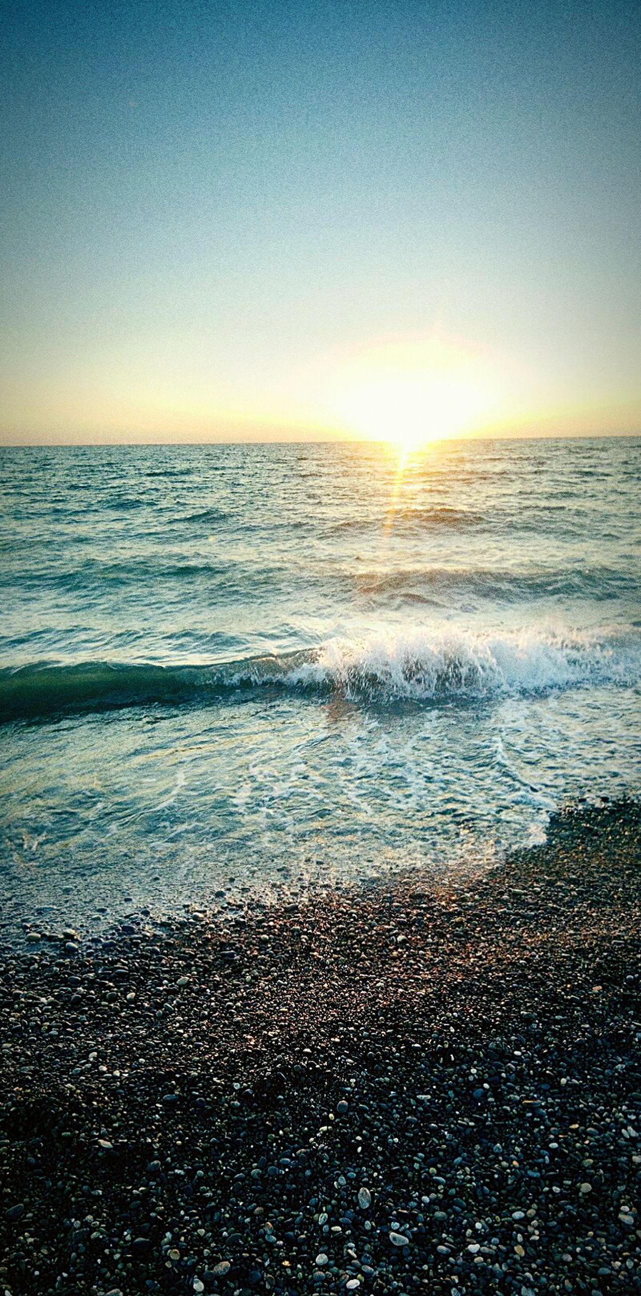 sea, horizon over water, water, beach, scenics, tranquil scene, shore, beauty in nature, tranquility, wave, sunset, nature, sky, clear sky, idyllic, sand, surf, seascape, copy space, coastline