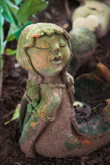 Clay dolls for mermaid garden decoration are covered with moss. Algae Clay Doll Close-up Cute Day Dirty Focus On Foreground Garden Decor Girl Green Color Growth Human Representation Lichens Mermaid Moss Nature No People Old Outdoors Sculpture Statue
