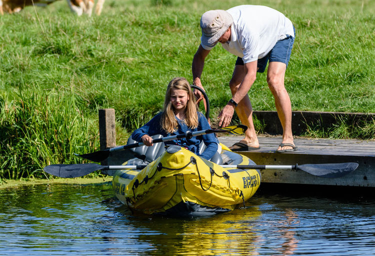 Boat launching on the river, Suffolk, UK Boating Having Fun River Collection River View Riverside Summertime Boat Launch Canoing Casual Clothing Launch Launching Leisure Activity River Riverbank Summer Summertime On The River Togetherness Two People