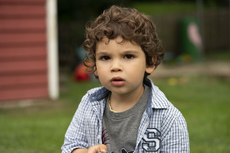 Portrait of cute boy in back yard