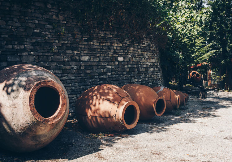 Pots by wall on sunny day