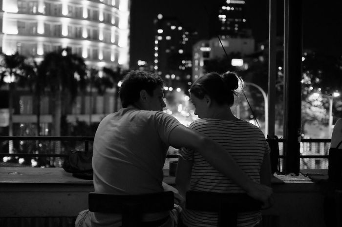 Real People People Two People Rear View Togetherness Men Bonding Lifestyles Leisure Activity Women City Night Illuminated Adult Outdoors Couple Adults Only Nightlife Monochrome Photography