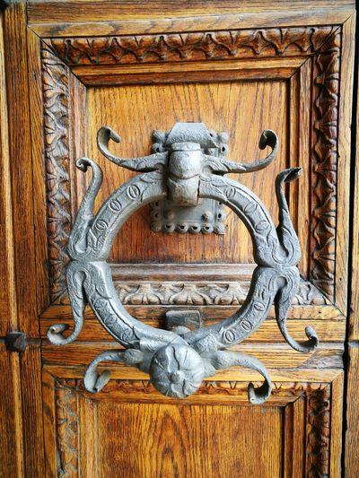 Close-up of wooden door knocker