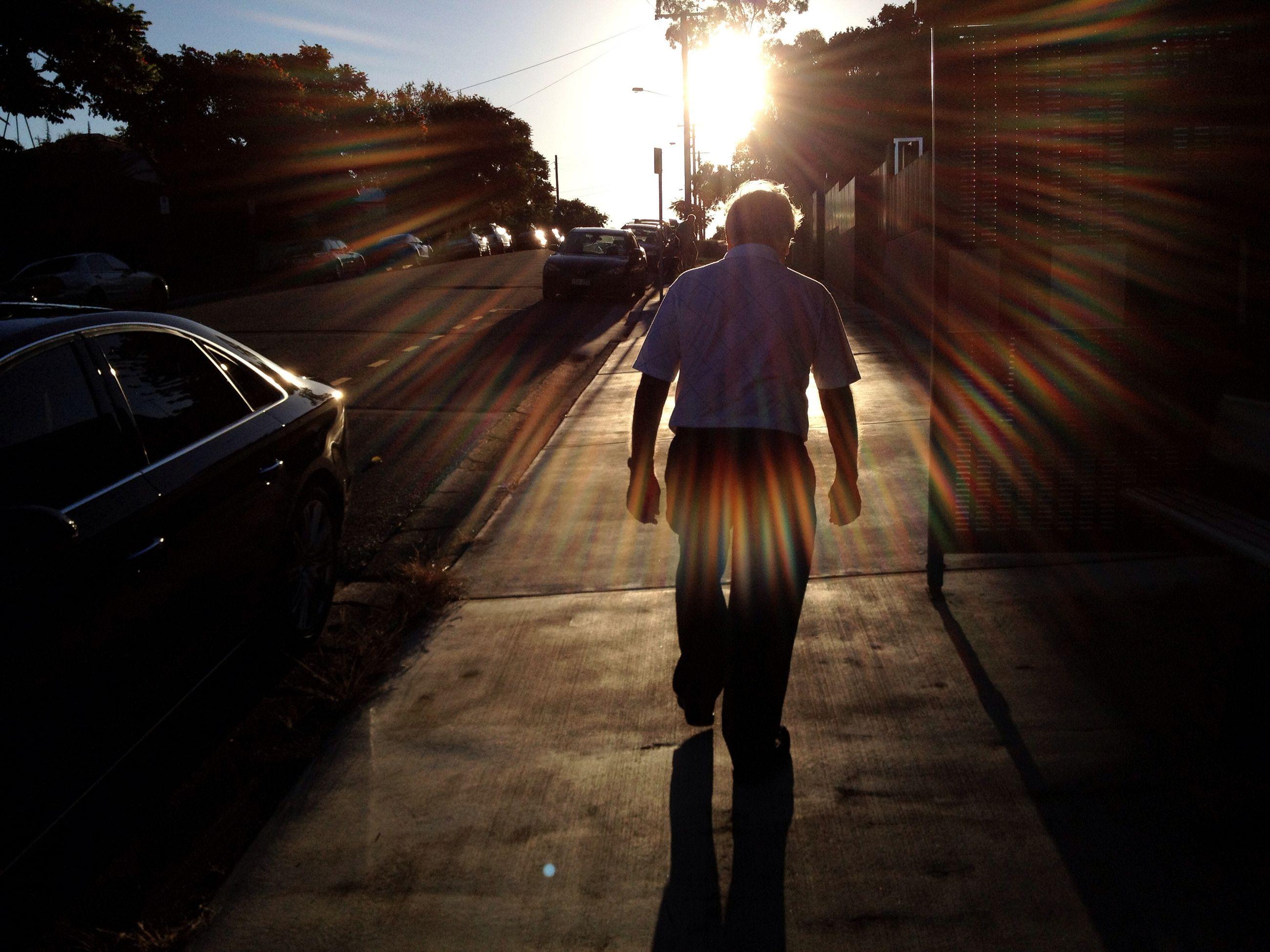 transportation, lifestyles, street, full length, sunlight, rear view, walking, shadow, men, leisure activity, road, sunbeam, the way forward, sun, on the move, mode of transport, car, land vehicle