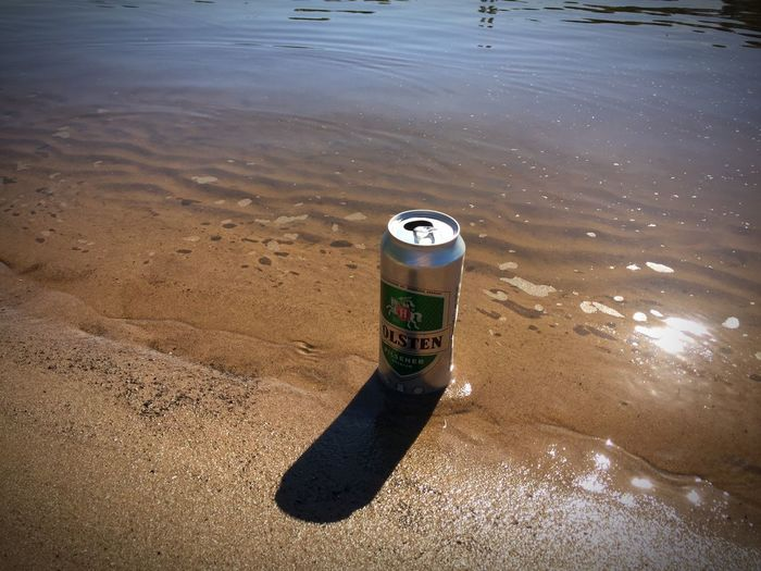 Relaxing Beer Time Beer Beach Holsten Water Nature No People High Angle View Beach Outdoors Land Sunlight Day Sand Single Object Shadow Sea