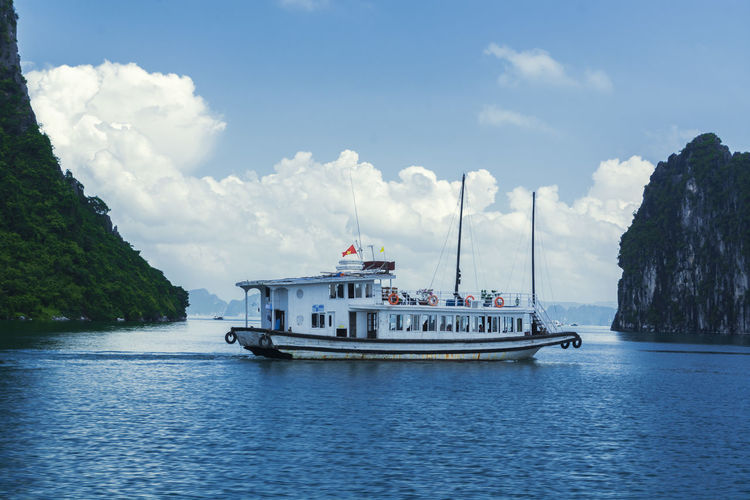 Vietnam Halong Bay Beauty In Nature Cloud - Sky Day Ferry Mode Of Transport Nature Nautical Vessel No People Outdoors Sailing Scenics Sea Sky Transportation Water Waterfront