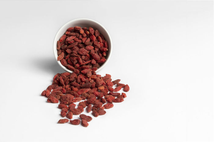 Alternative Medicine Close-up Condiment Day Dried Food Dried Fruit Food Food And Drink Freshness Goji Goji Berries Gojiberries Healthcare And Medicine Healthy Eating Herbal Medicine Indoors  Ingredient Legume Family No People Red Studio Shot Wellbeing White Background