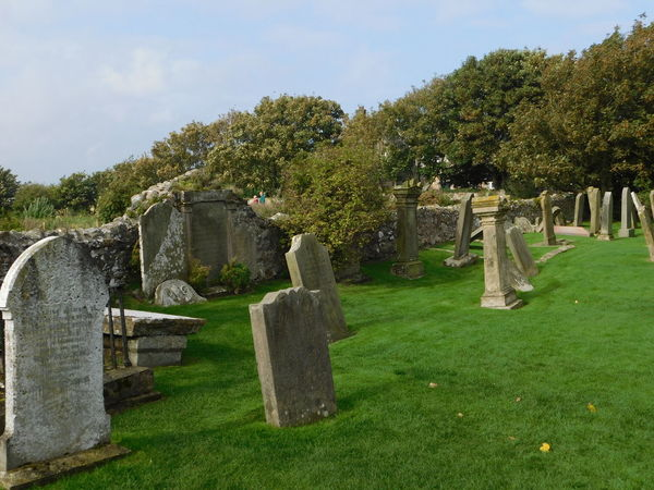 Graveyard on the beautiful magical and mystical island of Lindisfarne (The Holy Island) of the coast of Northumberland, England. Cemetery Day Grass Gravestone Graveyard Green Color Lindisfarne Memorial Nature No People Outdoors Sky The Past Tombstone Tree