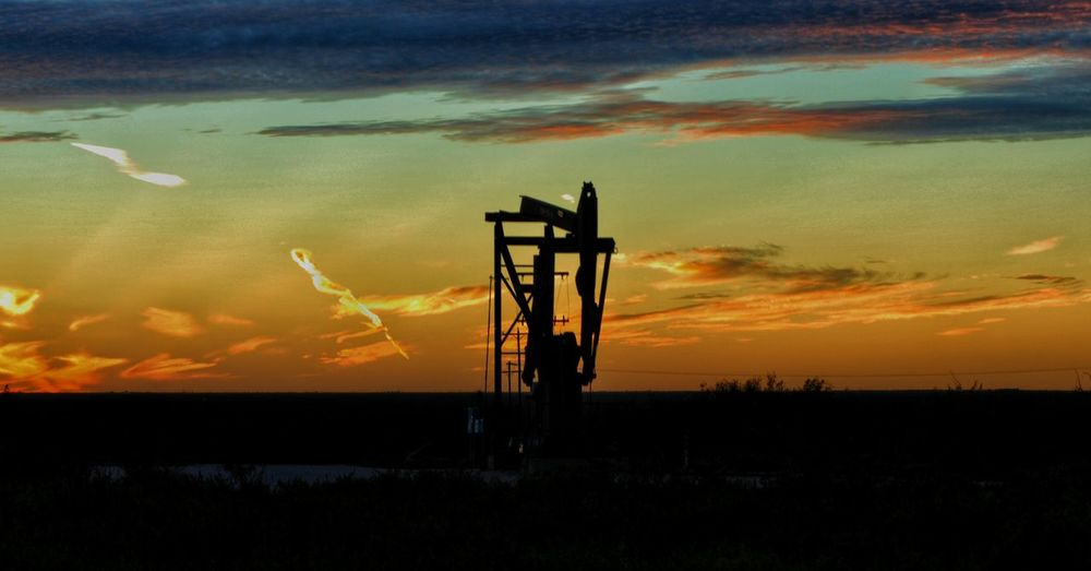 Oil Rig On Field Against Sky