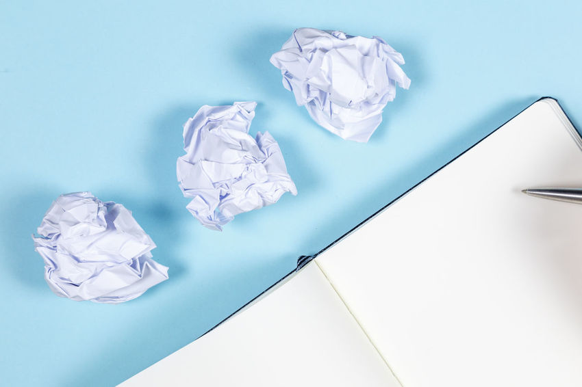 Crumpled Paper Indoors  Crumpled Paper No People Crumpled Paper Ball Studio Shot High Angle View Blue Copy Space Still Life Table Close-up Garbage Colored Background Frustration White Color Negative Emotion Blue Background Clean